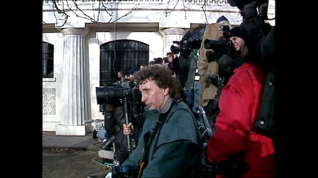 exterior shots of photographers standing around as they wait for princess diana's arrival at centrepoint on her last official engagement before... - fotograf stock-videos und b-roll-filmmaterial