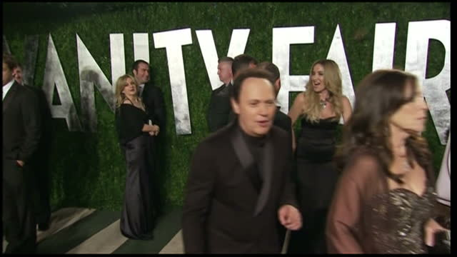 exterior shots of piers morgan tom jones and billy crystal on red carpetvalentino gown speaking to reporters at the vanity fair after party... - vanity fair stock videos and b-roll footage
