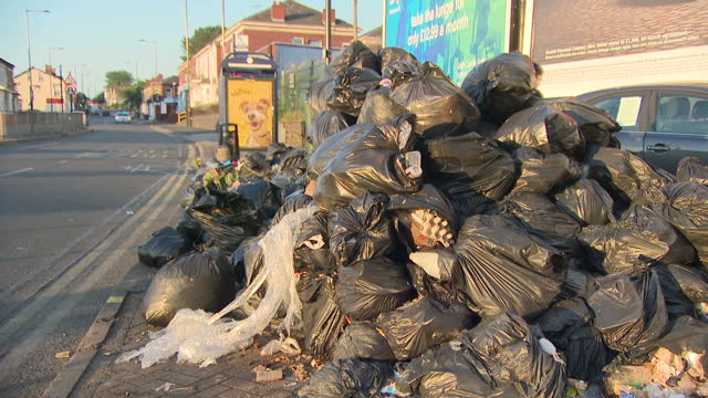 exterior shots of piled up rubbish bags that are overflowing with uncollected rubbish due to the refuse worker strike in birmingham the waste is... - bin bag stock videos & royalty-free footage