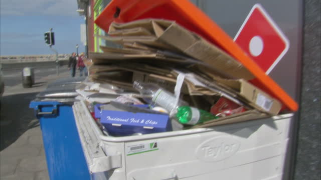 exterior shots of piles of rubbish in an overflowing public recycling bin on 17 april 2017 in margate, united kingdom - overflowing stock videos & royalty-free footage