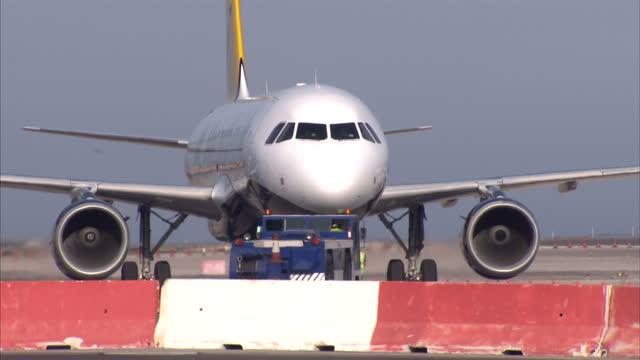 exterior shots of planes at gibraltar airport and people walking across runway planes and people at gibraltar airport on august 19 2013 in gibraltar... - gibraltar bildbanksvideor och videomaterial från bakom kulisserna