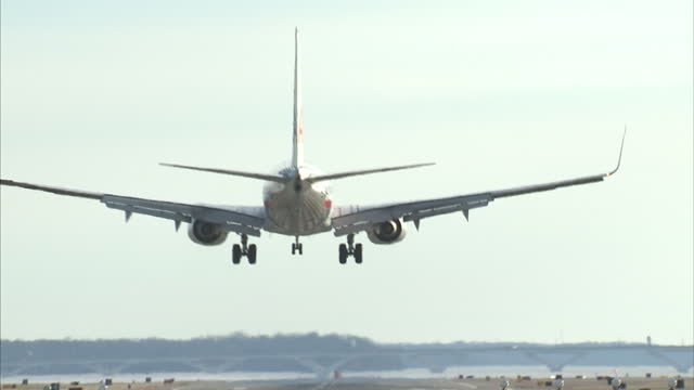 stockvideo's en b-roll-footage met exterior shots of planes landing and taking off from san francisco international airport including us airways and american airlines on january 29... - us airways