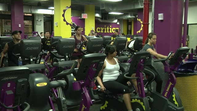 stockvideo's en b-roll-footage met exterior shots of planet fitness signage at a location in new york city sign inside a planet fitness gym reads lunk alarm a low angle shot of people... - ellips