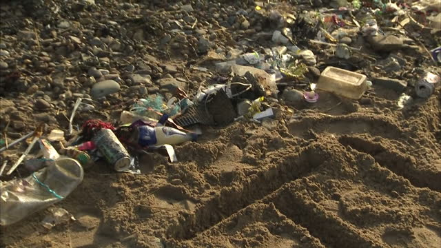 exterior shots of plastic rubbish waste washed up on weston super mare beach with the word 'plastic' written in the sand on january 24 2017 in weston... - weston super mare stock videos and b-roll footage