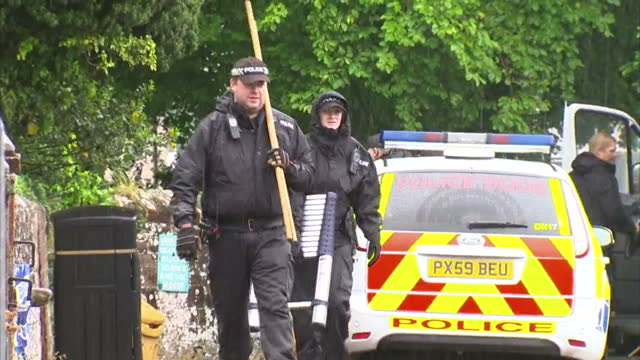 exterior shots of police activity outside the cordoned off cemetery where the body of murdered teenager jordan watson was found>> on june 17 2015 in... - seilabsperrung stock-videos und b-roll-filmmaterial