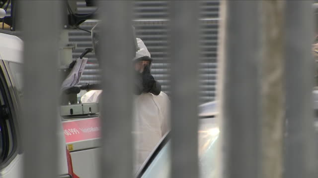 exterior shots of police and army forensics team at ashley woods recovery garage where the car of former spy sergei skripal was taken on 1 may 2018... - sergei skripal stock videos and b-roll footage