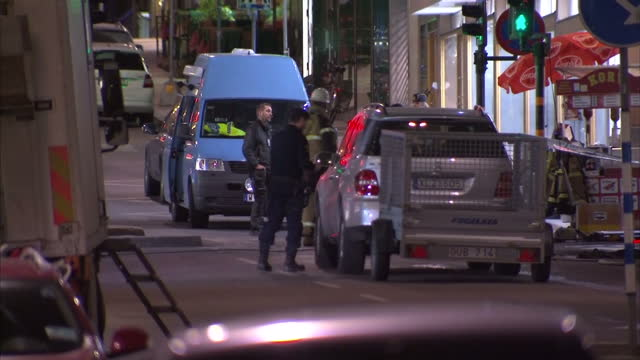 exterior shots of police and investigators at the scene of a lorry attack in a shopping area on 7 april 2017 in stockholm sweden - terrorism stock videos & royalty-free footage