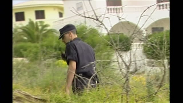 exterior shots of police and members of the public searching waste ground outside the ocean club apartments for missing british girl madeleine mccann - madeleine mccann stock videos & royalty-free footage