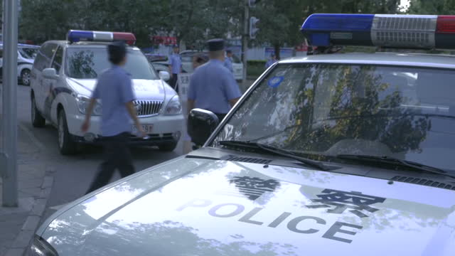 exterior shots of police and security guards enforcing road closures near the philippine embassy during a dispute between china and the philippines... - south china sea stock videos & royalty-free footage