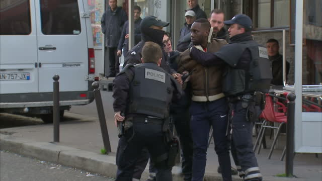 Exterior shots of police arresting a man who had been trying to show Sky News's Europe Correspondent Mark Stone a mobile phone video of the aftermath...