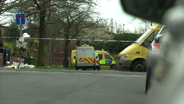 exterior shots of police at the scene in worcester road of the discovery of the bodies of bernadette fox and daughter sarah and floral tributes left... - merseyside stock videos and b-roll footage