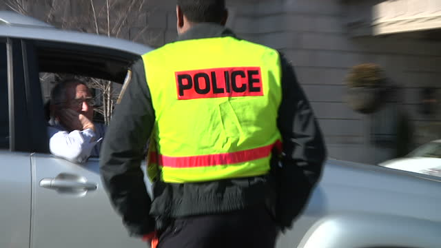 exterior shots of police cars and police putting out barricades near the white house prior to the second inauguration of barack obama on january 21,... - barricade stock videos & royalty-free footage