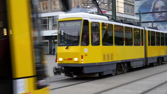 Exterior shots of police cars driving on street next to trams at Alexanderplatz on December 20 2016 in Berlin Germany A truck deliberately steered...