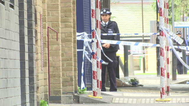 exterior shots of police officers an incident tent and cordon tape at the scene of a stabbing murder in canterbury place southwark on september 15... - gun crime stock videos & royalty-free footage