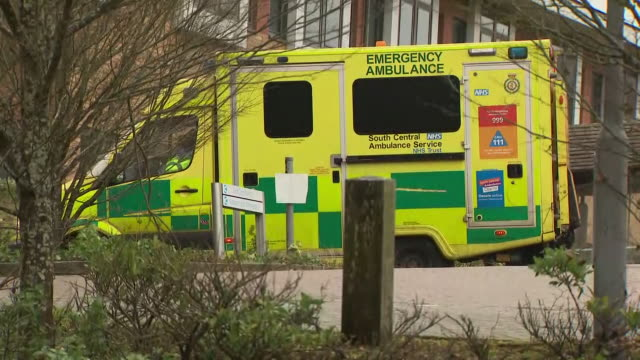 exterior shots of police officers and health officials waiting as coaches arrive at kent hill park conference centre which has been re purposed as a... - nationals park stock videos & royalty-free footage