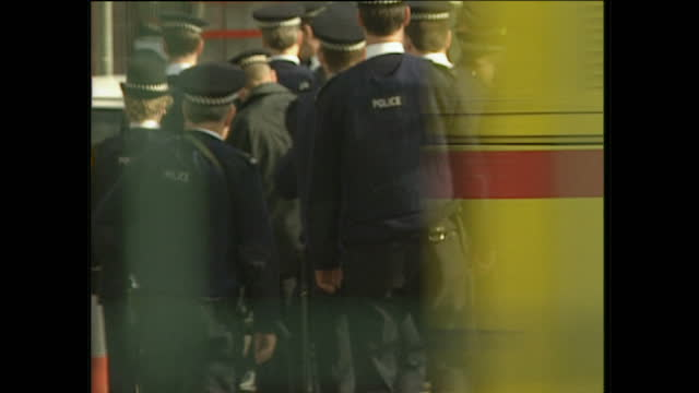 exterior shots of police officers arriving at the scene of the ira docklands bombing for a team briefing on february 10, 1996 in london, england. - london docklands stock videos & royalty-free footage