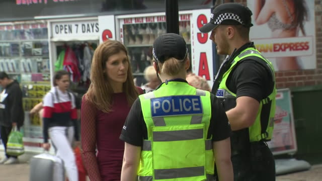 vidéos et rushes de exterior shots of police officers equipped with taser out patrolling streets on 20 august 2019 in northampton, united kingdom. - northampton