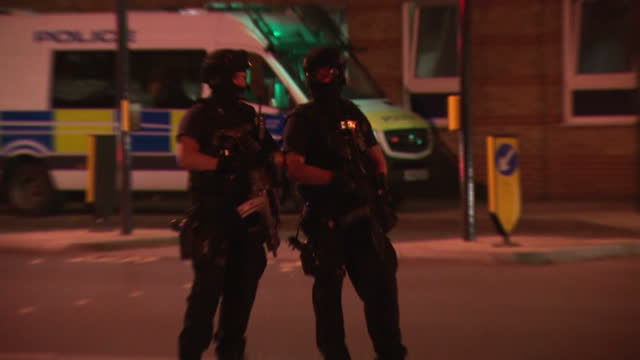 exterior shots of police officers guarding cordoned off streets near the scene of the london bridge terror attack including armed officers on june 03... - terrorism stock videos & royalty-free footage