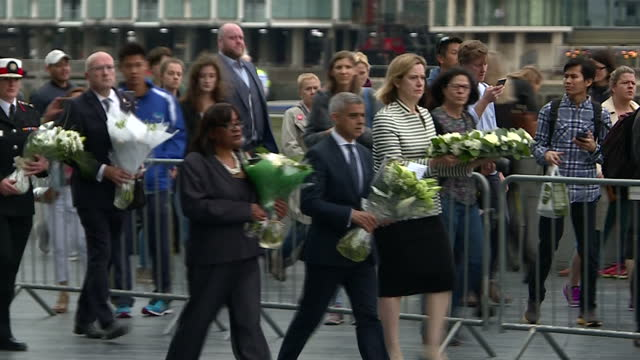 Exterior shots of police officers laying flowers outside City Hall followed by Mayor of London Sadiq Khan Home Secretary Amber Rudd and Shadow Home...