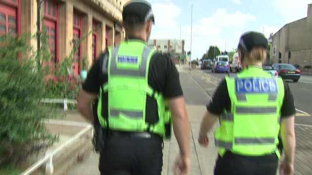 vidéos et rushes de exterior shots of police officers out patrolling streets and carrying tasers on 20 august 2019 in northampton, united kingdom. - northampton