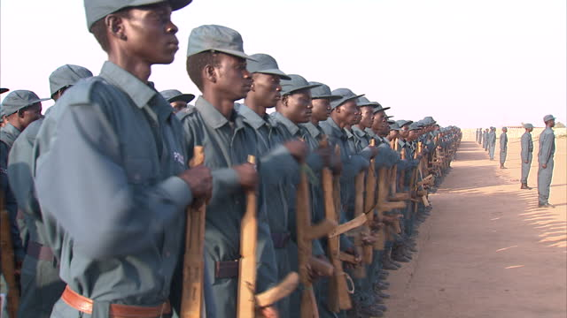 exterior shots of police recruits training with wooden guns in southern sudan recruits train ahead of a referendum on southern independence in rajaf... - ジュバ市点の映像素材/bロール