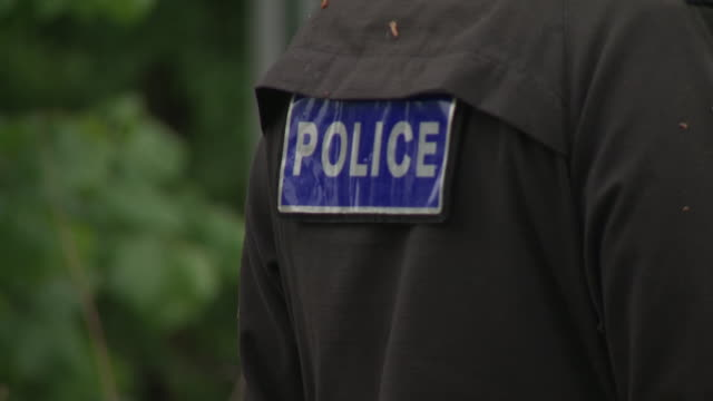exterior shots of police sign on the jacket of an officer on 28 april 2020 in godstone surrey united kingdom - looking stock videos & royalty-free footage