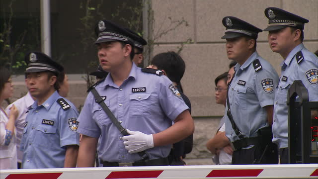 Exterior shots of police street scenes outside Chaoyang court entrance Chinese petitioners outside Beijing Supreme Court on June 23 2010 in Beijing...