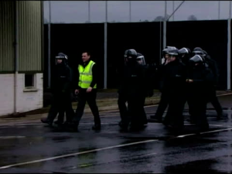 vidéos et rushes de exterior shots of police training exercise using water cannon and armoured land rovers. - 50 secondes et plus