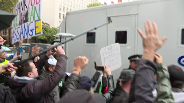 exterior shots of police van surrounded by by julian assange supporters protesting his possible extradition departing from westminster magistrates... - whistleblower human role stock videos & royalty-free footage