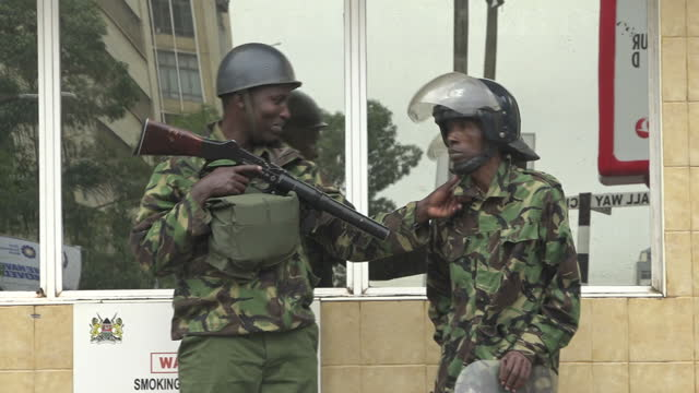 exterior shots of police with riot gear stood guard in front of the supreme court as a woman shouts in protest on 25 october 2017 in nairobi kenya - oberster gerichtshof stock-videos und b-roll-filmmaterial