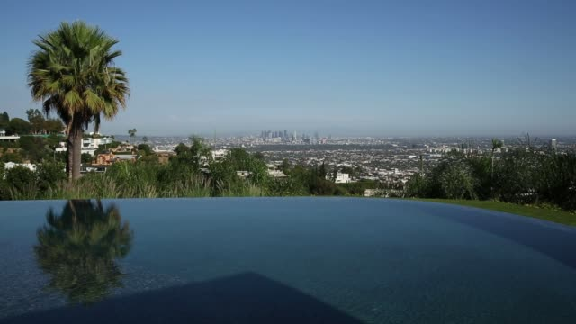 exterior shots of pool overlooking los angeles at 1181 n hillcrest road, an eight bedroom, 15 bath mansion at trousdale estates in beverly hills,... - beverly hills california stock-videos und b-roll-filmmaterial