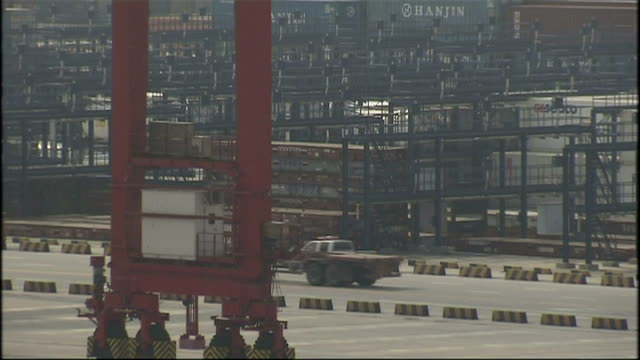 exterior shots of port workers and large shipping containers being moved shanghai container port on october 21, 2008 in shanghai, china. - film container stock videos & royalty-free footage