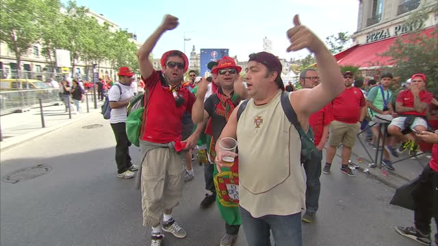 vídeos de stock, filmes e b-roll de exterior shots of portuguese and welsh football fans celebrating in the centre of lyon prior to the two sides' clash in the euro 2016 semi finals on... - olympique lyonnais