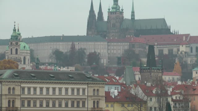 exterior shots of prague city centre including the charles bridge over the river vltava, buildings, trams and traffic on november 12, 2014 in prague,... - river vltava stock videos & royalty-free footage
