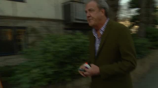 exterior shots of presented and columnist jeremy clarkson returning to his london home as paparazzi take photographs and journalists ask questions,... - columnist stock videos & royalty-free footage