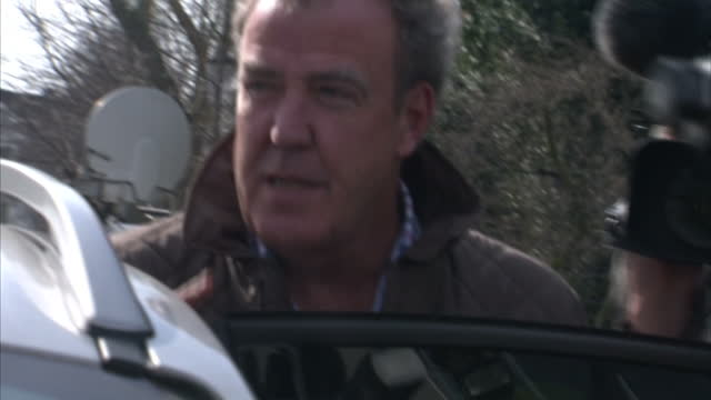 exterior shots of presenter and columnist jeremy clarkson being mobbed by journalists asking him to comment on his suspension by the bbc clarkson... - columnist stock videos and b-roll footage