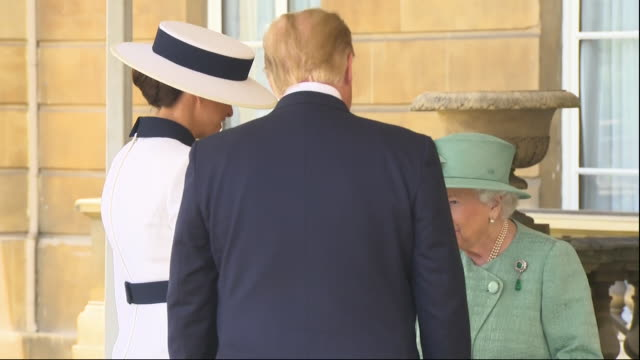 exterior shots of president donald trump and wife melania trump greeting the queen on the back steps of buckingham palace before walking inside on 3... - queen royal person stock videos & royalty-free footage