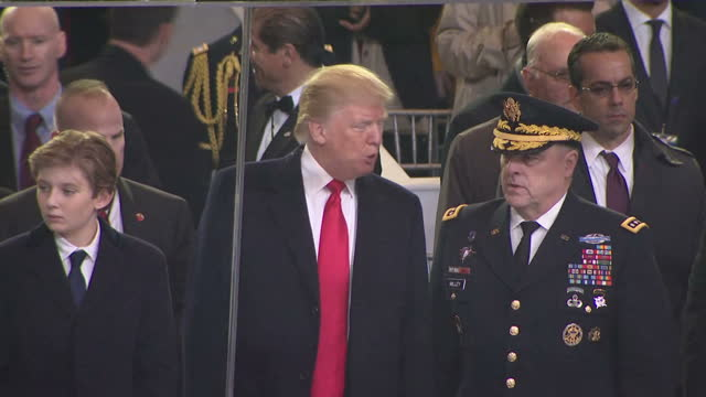 Exterior shots of President Elect Donald J Trump sat with wife Melaina son Baron Trump and others on the White House lawn watching the...