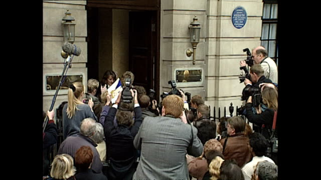 exterior shots of press and members of public waiting outside the royal college of nursing; exterior shots of princess diana push through crowd as... - schieben stock-videos und b-roll-filmmaterial