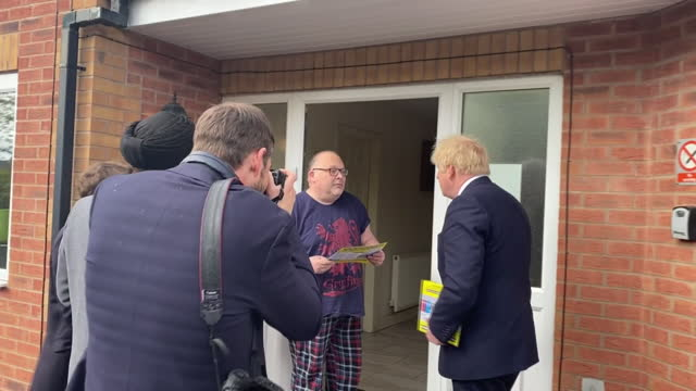 GBR: Prime Minister Boris Johnson doorsteps constituents ahead of parliamentary elections.