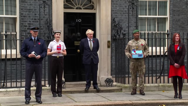 exterior shots of prime minister boris johnson outside downing street with servicemen launching the annual poppy appeal on 23 october 2020 in london,... - armistice stock videos & royalty-free footage