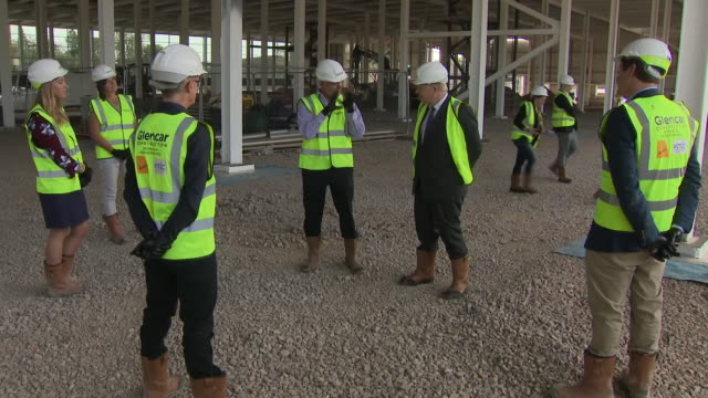 exterior shots of prime minister boris johnson wearing hard hat and high visibility jacket on a tour of the new vaccines manufacturing and innovation... - making stock videos & royalty-free footage