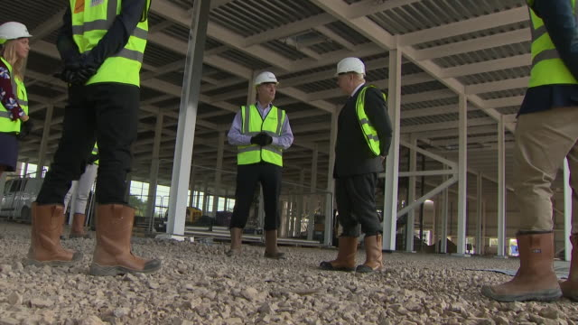 exterior shots of prime minister boris johnson wearing hard hat and high visibility jacket on a tour of the new vaccines manufacturing and innovation... - manufacturing stock videos & royalty-free footage