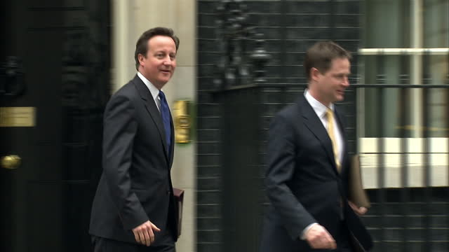 exterior shots of prime minister david cameron and deputy prime minister nick clegg depart downing street together david cameron nick clegg depart... - ニック クレッグ点の映像素材/bロール