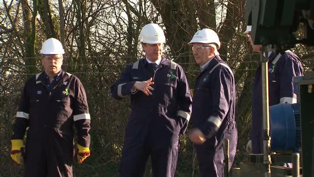 vídeos de stock, filmes e b-roll de exterior shots of prime minister david cameron visiting an onshore oil drilling site near gainsborough lincolnshire david cameron visits oil drilling... - david cameron político
