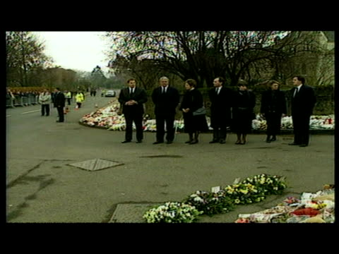 exterior shots of prime minister john major and wife norma walk carrying a wreath before placing it with other tributes. exterior shots of tony... - dunblane stock videos & royalty-free footage