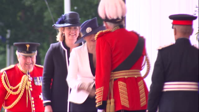 Exterior shots of Prime Minister Theresa May and Home Secretary Amber Rudd arriving at Horseguards Parade and greeting officials before a ceremony to...