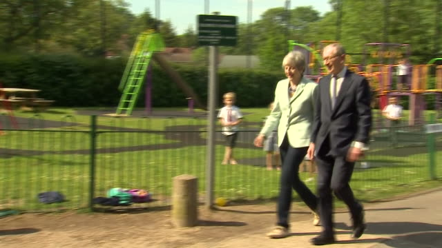 exterior shots of prime minister theresa may and husband philip walking into their polling station and departing after voting in the european... - staatsdienst stock-videos und b-roll-filmmaterial