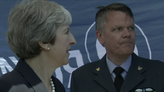 vídeos y material grabado en eventos de stock de exterior shots of prime minister theresa may chatting with raf personnel shaking hands with a group of gurkha soldiers and a quick photo call for the... - gurkha