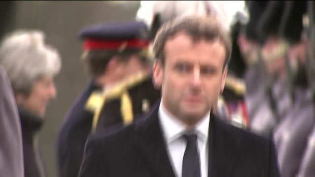 Exterior shots of Prime Minister Theresa May greeting French President Emmanuel Macron before a bilateral summit at the Royal Military Academy...